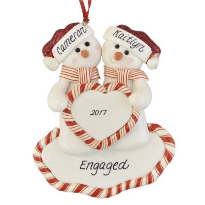 An Engaged Snow Couple personalized christmas ornaments