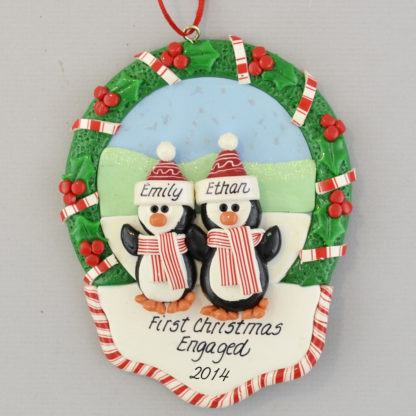 Engaged Penguin Couple in a Christmas Wreath personalized Ornaments
