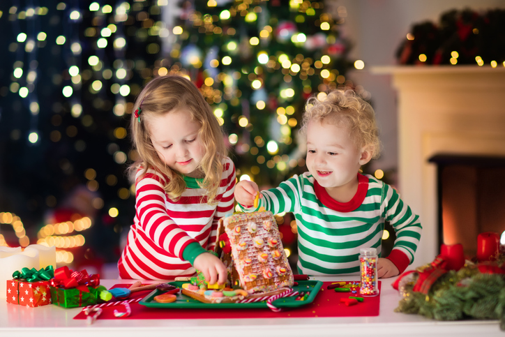 two little kids prep for Christmas decorations