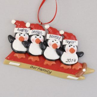 Four Penguins Sledding Personalized Christmas Ornament