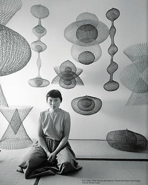 Ruth Azawa posing next to her creations